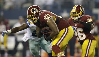 Washington Redskins outside linebacker Rob Jackson (50) comes up with an interception thrown by Dallas Cowboys quarterback Tony Romo in the first half of an NFL football game on Sunday, Oct. 13, 2013, in Arlington, Texas. (AP Photo/Tim Sharp)