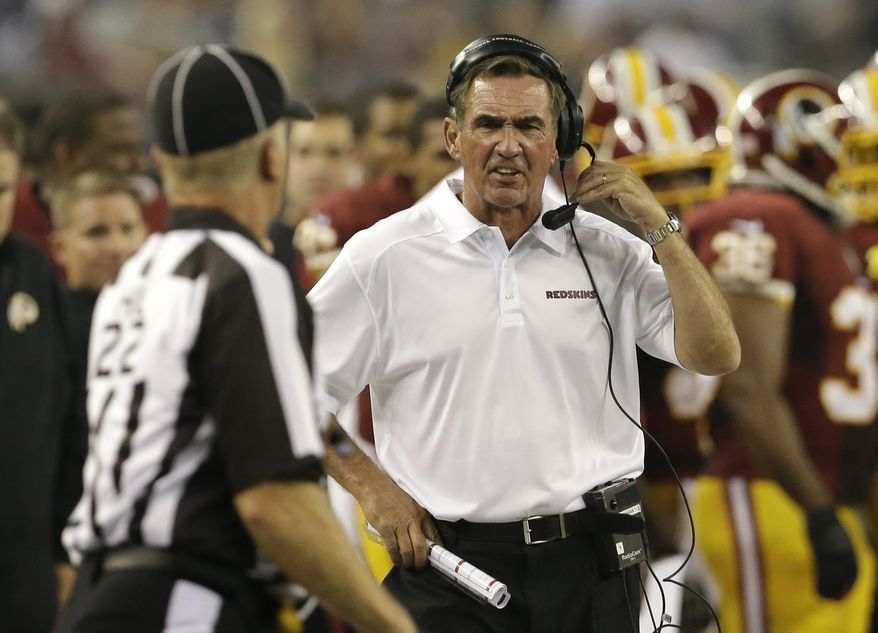 Washington Redskins head coach Mike Shanahan, right, shouts in the first half of an NFL football game against the Dallas Cowboys, Sunday, Oct. 13, 2013, in Arlington, Texas. (AP Photo/LM Otero)