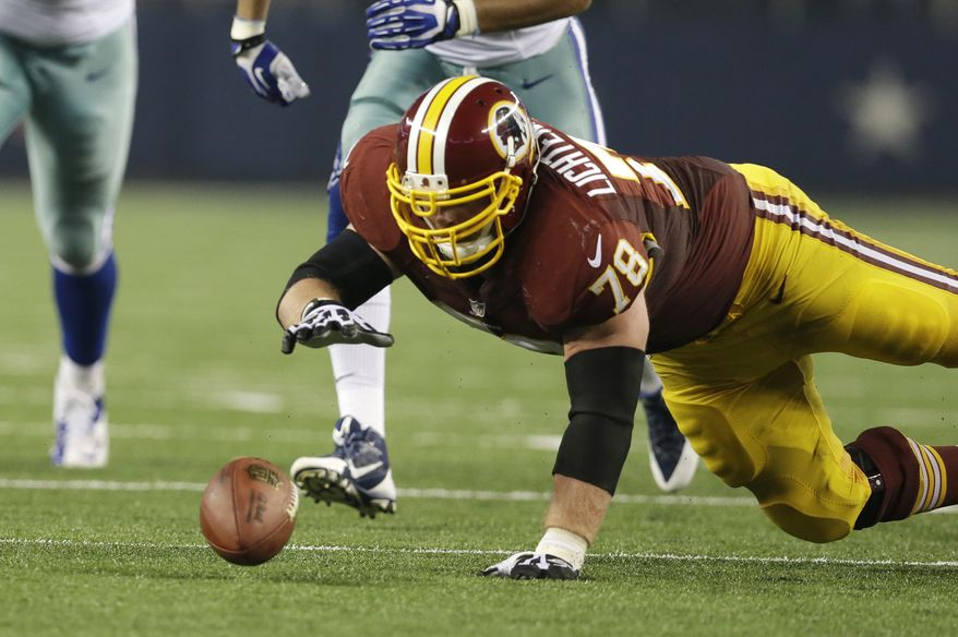 Washington Redskins guard Kory Lichtensteiger (78) recovers a fumble in second half of an NFL football game against the Dallas Cowboys Sunday, Oct. 13, 2013, in Arlington, Texas. (AP Photo/LM Otero)