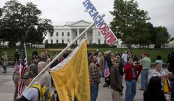 """A man, who asked to be identified only as """"Frank"""", carries and """"Impeach Obama"""" sign while protesting with others outside the White House in Washington Sunday, Oct. 13, 2013, as the partial government shutdown enters its third week.  (AP Photo/Carolyn Kaster)"""