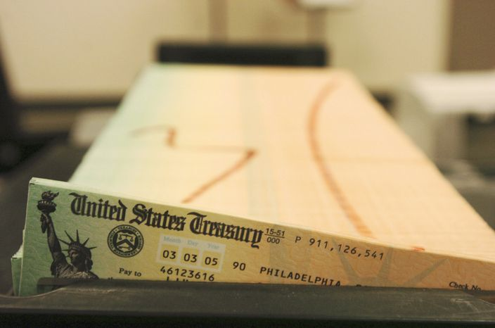 ** FILE ** In this Feb. 11, 2005, file photo, trays of printed Social Security checks wait to be mailed from the U.S. Treasury's Financial Management services facility in Philadelphia. (AP Photo/Bradley C. Bower, File)