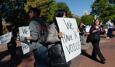 YOUNG VOICES: University of Michigan students participate in a Freeze Out rally to promote diversity on the University of Michigan campus in Ann Arbor this month. (ANN ARBOR (MICH.) NEWS Via Associated Press)