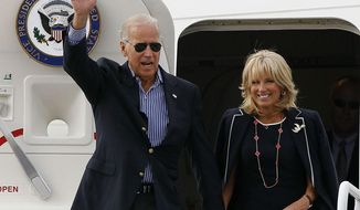 ** FILE ** Vice President Joseph R. Biden and his wife, Jill, arrive in Charlotte, N.C., on Sept. 4, 2012, to attend the Democratic National Convention. (Associated Press)