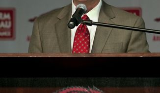 **FILE** Arkansas athletic director Jeff Long speaks during a media conference to announce Bret Bielema's hire as the new NCAA college football coach in Fayetteville, Ark., Wednesday, Dec 5, 2012. (AP Photo/April L. Brown)