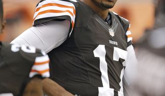 Cleveland Browns quarterback Jason Campbell watches during an NFL football game between the Detroit Lions and the Browns Sunday, Oct. 13, 2013, in Cleveland. (AP Photo/Tony Dejak)