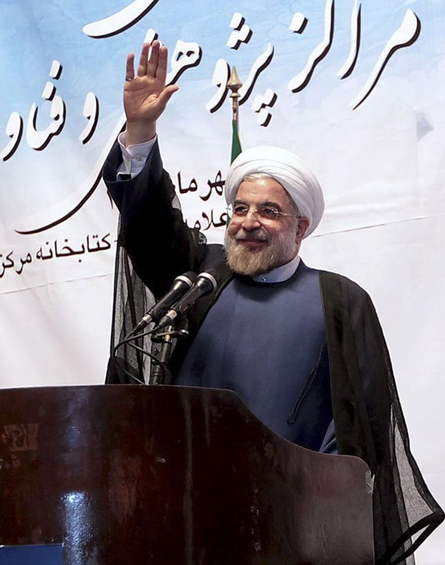 Iranian President Hassan Rouhani waves during a ceremony to mark the beginning of Tehran University's academic year on Monday, Oct. 14, 2013, in Tehran. (AP Photo/Presidency Office, Ebrahim Seyyedi)