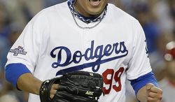 Los Angeles Dodgers starting pitcher Hyun-Jin Ryu celebrates after getting the last out to end the seventh inning of Game 3 of the National League baseball championship series against the St. Louis Cardinals, Monday, Oct. 14, 2013, in Los Angeles.  (AP Photo/David J. Phillip)