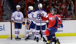 Washington Capitals right wing Alex Ovechkin (8), from Russia, celebrates his goal in the second period of an NHL hockey game against the Edmonton Oilers, Monday, Oct. 14, 2013, in Washington . (AP Photo/Alex Brandon)