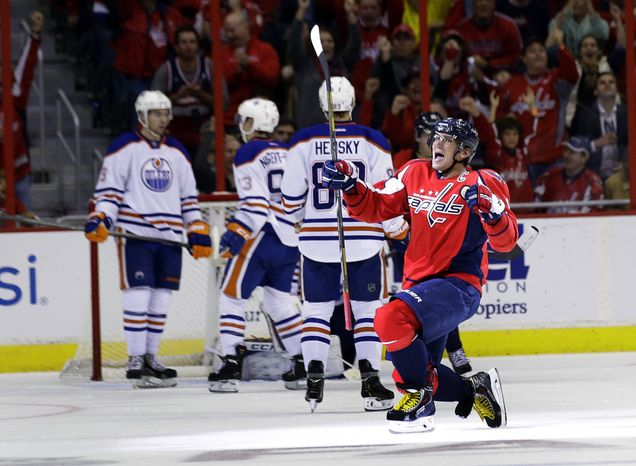 Washington Capitals right wing Alex Ovechkin (8), from Russia, celebrates his goal in the second period of an NHL hockey game against the Edmonton Oilers, Monday, Oct. 14, 2013, in Washington . (AP Photo/Alex