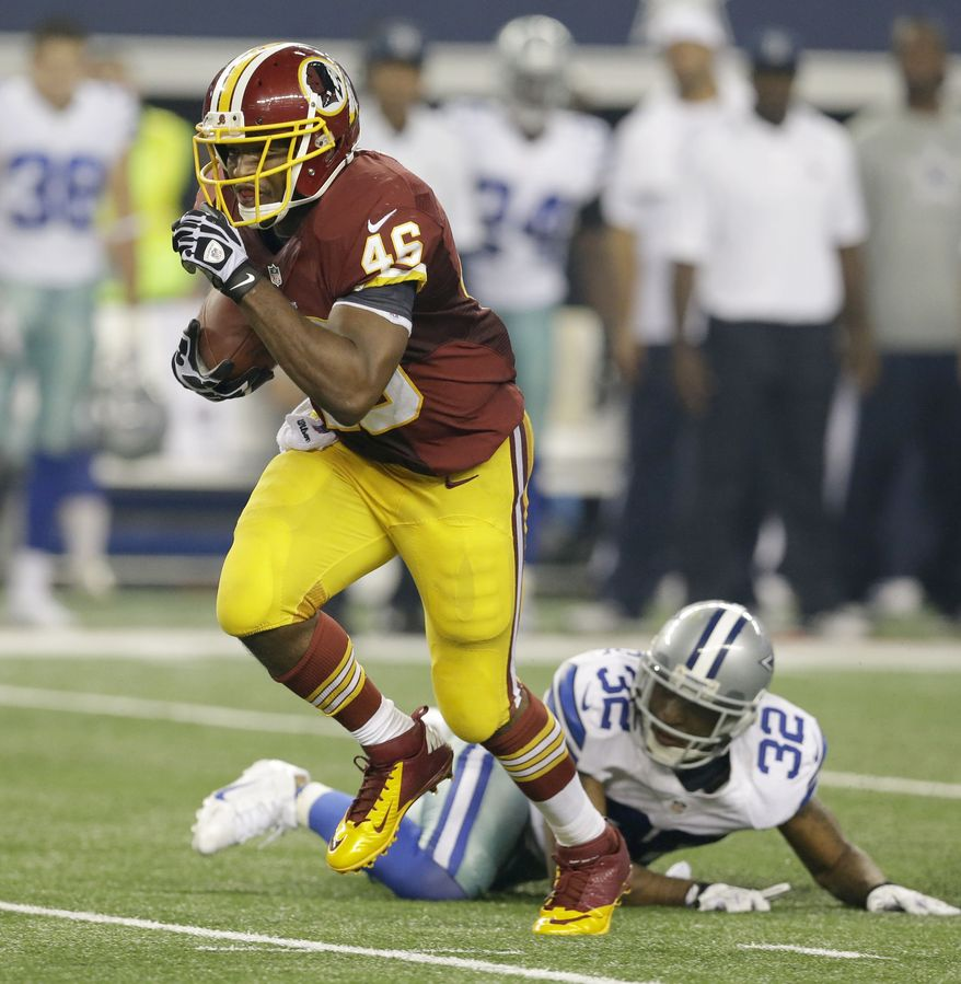Washington Redskins running back Alfred Morris (46) is beats Dallas Cowboys cornerback Orlando Scandrick (32) during the second half of an NFL football game Sunday, Oct. 13, 2013, in Arlington, Texas. (AP Photo/LM Otero)
