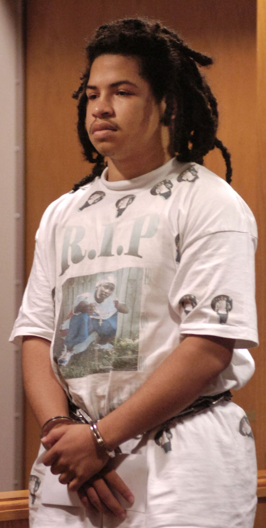 ** FILE ** In this Dec. 1, 2007, file photo, Eric Rivera Jr., 17, listens to Lee Circuit Judge Hugh Starnes during his first appearance at the Lee County Justice Center in Fort Myers, Fla. (AP Photo/The Fort Myers News-Press, Stephen Hayford)