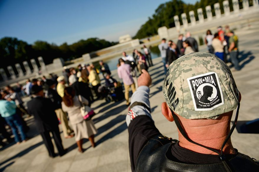 Veteran Al Bailey of Highland, Md., attends a rally for veterans and military members Tuesday on the Mall calling for an end to the federal government shutdown at the World War II Memorial. (andrew harnik/the washington times)