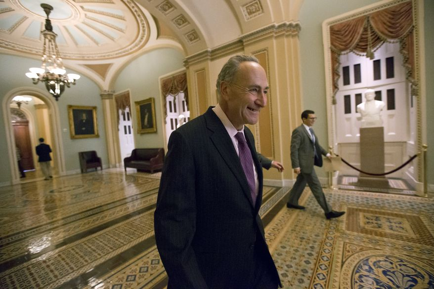 ** FILE ** Sen. Chuck Schumer, New York Democrat, returns to the floor from a caucus luncheon at the Capitol in Washington, Tuesday, Oct. 15, 2013. (AP Photo/J. Scott Applewhite)