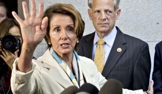 House Minority Leader Nancy Pelosi and Rep. Steve Israel, chairman of the Democratic Congressional Campaign Committee, are among top Democrats impugning Republicans as racist. (AP Photo/J. Scott Applewhite)