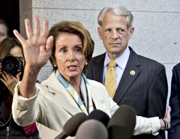 House Minority Leader Nancy Pelosi and Rep. Steve Israel, chairman of the Democratic Congressional Campaign Committee, are among top Democrats impugning Republicans as racist. (AP Photo/J. Scott Applewhi