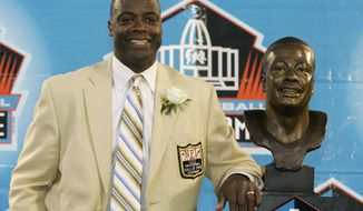 FILE - In this Aug. 2, 2008 file photo, former Washington Redskins cornerback Darrell Green stands next to his bronze bust at the Pro Football Hall of Fame in Canton, Ohio. The former Redskins cornerback looks around today's NFL and sees a lack of talent at his old job. (AP Photo/Kiichiro Sato, File)