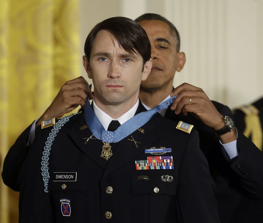 President Barack Obama awards the Medal of Honor to former Army Capt. William D. Swenson of Seattle, Wash., during a ceremony in the East Room at the White House in Washington, Tuesday, Oct. 15, 2013. Swenson was being awarded the Medal of Honor for his actions in a lengthy battle against the Taliban insurgents in the Ganjgal valley near the Pakistan border on Sept. 8, 2009, which claimed the lives of five Americans, 10 Afghan army troops and an interpreter. (AP Photo/Pablo Martinez Monsivais)