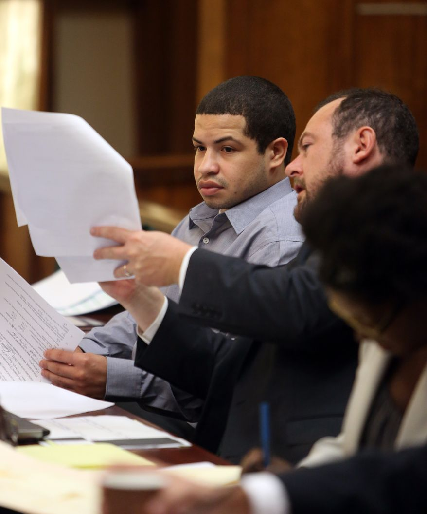 Eric Rivera Jr., left, talks with attorney   Christopher Brown during jury selection Monday, Oct.15, 2013, in Miami.  Rivera is accused  in the 2007 slaying of Washington Redskins star safety Sean Taylor during what police say was a botched burglary attempt. (AP Photo/The Miami Herald, Walter Michot, pool)