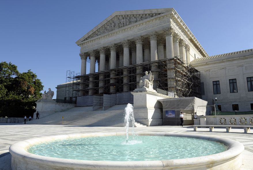 The Supreme Court, shown Tuesday, Oct. 15, 2013 in Washington, has agreed to consider whether the Environmental Protection Agency overstepped its authority in developing rules aimed at cutting emissions of six heat-trapping gases from factories and power plants.  The justices said Tuesday they will review a unanimous federal appeals court ruling that upheld the government's unprecedented regulations aimed at reducing the gases blamed for global warming. (AP Photo/Susan Walsh)