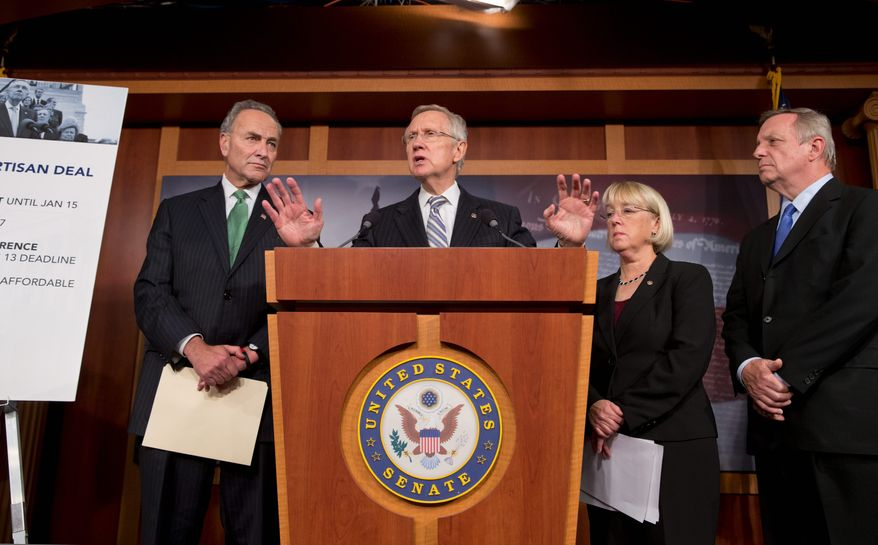 Senate Majority Leader Harry Reid, Nevada Democrat,  (center) speaks to reporters after the Senate voted  on the deal.  Looking on are Senate Democrats Charles E. Schumer of New York (left),  Patty Murray of Washington and Richard J. Durbin of Illinois. (Associated Press)