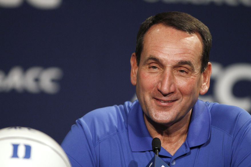 Duke coach Mike Krzyzewski smiles during the Atlantic Coast Conference NCAA college basketball media day in Charlotte, N.C., Wednesday, Oct. 16, 2013. (AP Photo/Nell Redmond)