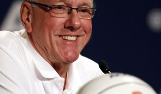 Syracuse coach Jim Boeheim smiles during a press conference at the Atlantic Coast Conference NCAA college basketball media day in Charlotte, N.C., Wednesday, Oct. 16, 2013. (AP Photo/Nell Redmond)