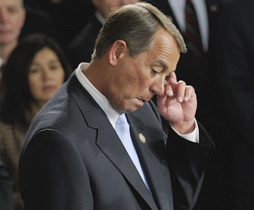**FILE** House Speaker-designate John Boehner of Ohio wipes a tear while waiting to receive the gavel from outgoing House Speaker Nancy Pelosi of Calif. the during the first session of the 112th Congress, on Capitol Hill in Washington. (Associated Press)