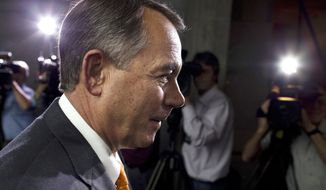 ** FILE ** Speaker of the House Rep. John Boehner, R-Ohio, walks past reporters after a meeting with House Republicans on Capitol Hill on Wednesday, Oct. 16, 2013, in Washington. (AP Photo/Evan Vucci)