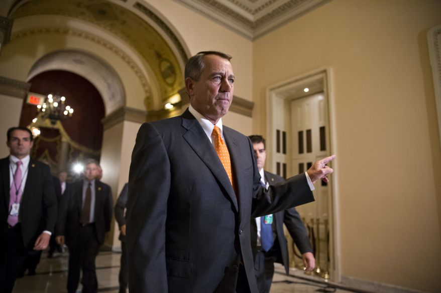 Speaker of the House John Boehner, R-Ohio, walks to the chamber for the vote on a Senate-passed bill that would avert a threatened Treasury default and reopen the government after a partial, 16-day shutdown, at the Capitol in Washington, Wednesday, Oct. 16, 2013.  (AP Photo/J. Scott Applewhite)