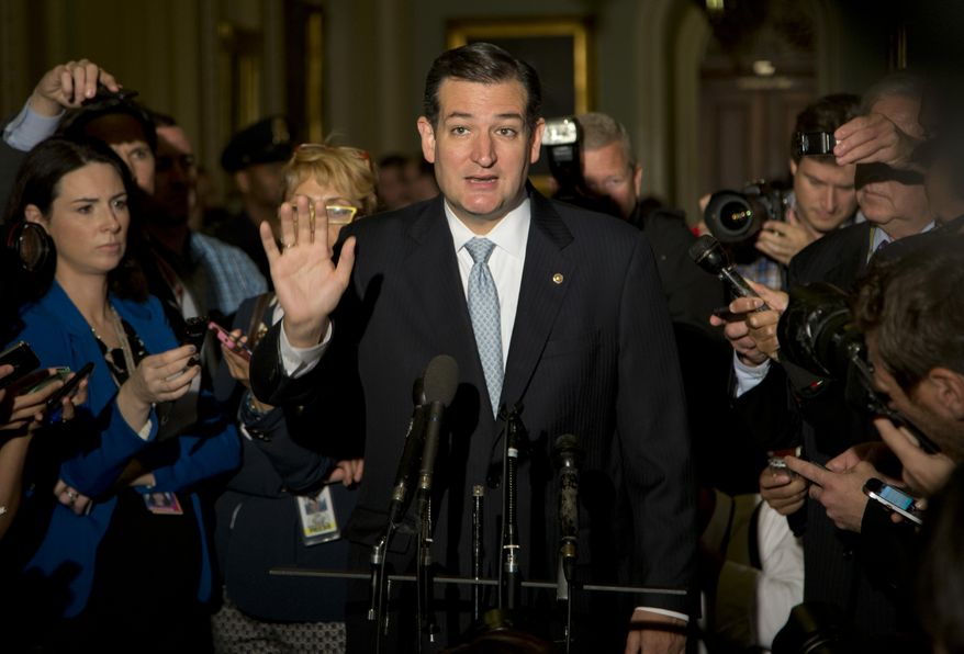 Sen. Ted Cruz, R-Texas, gestures as he talks with reporters on Capitol Hill, Wednesday, Oct. 16, 2013, in Washington. Sen. McConnell and his Democratic counterpart, Senate Majority Leader Harry Reid, D-Nev., are optimistic about forging an eleventh-hour bipartisan deal preventing a possible federal default and ending the partial government shutdown after Republican divisions forced GOP leaders to drop efforts to ram their own version through the House. (AP Photo/Carolyn Kaster)