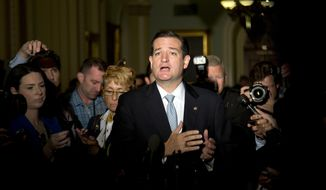 Sen. Ted Cruz, R-Texas, gestures as he talks with reporters on Capitol Hill, Wednesday, Oct. 16, 2013, in Washington. Leaders reached a last-minute agreement to avert a threatened Treasury default and reopen the government after a partial, 16-day shutdown. Cruz said he would not try to block the agreement. (AP Photo/Carolyn Kaster)