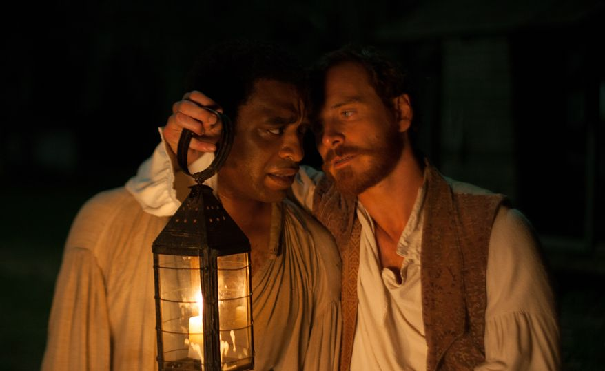 """This image released by Fox Searchlight shows Chiwetel Ejofor, left, and Michael Fassbender in a scene from """"12 Years A Slave."""" (AP Photo/Fox Searchlight, Francois Duhamel)"""