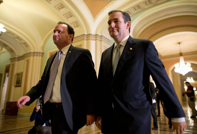 Republicans Sens. Mike Lee of Utah (left) and Ted Cruz of Texas walk to the Senate floor to vote on a bill to raise the debt ceiling and open the federal government. (Associated Press)