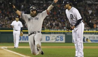Boston Red Sox's Mike Napoli scores on a wild pitch by Detroit Tigers' Anibal Sanchez, right, in the third inning during Game 5 of the American League baseball championship series Thursday, Oct. 17, 2013, in Detroit. (AP Photo/Matt Slocum)