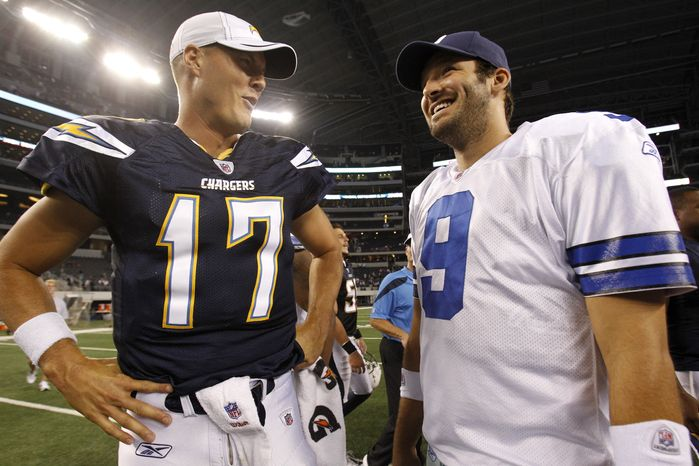**FILE** San Diego Chargers quarterback Philip Rivers (17) and Dallas Cowboys quarterback Tony Romo (9) talk on the field following their preseason NFL football game Sunday, Aug. 21, 2011, in Arlington, Texas. The