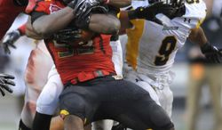 **FILE** Maryland's L.A. Goree (53) holds on to the football after recovering a fumble against Towson during the second half of an NCAA college football game, Saturday, Oct. 1, 2011, in College Park. Md. Maryland won 28-3. (AP Photo/Gail Burton)