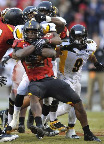 **FILE** Maryland's L.A. Goree (53) holds on to the football after recovering a fumble against Towson during the second half of an NCAA college football game, Saturday