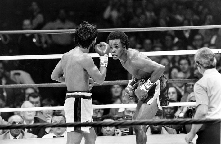 FILE - In this Nov. 25, 1980 file photo, Sugar Ray Leonard, right, taunts at Roberto Duran in the ring during a WBC Welterweight Championship fight refereed by Octavio Meyran in New Orleans, La.