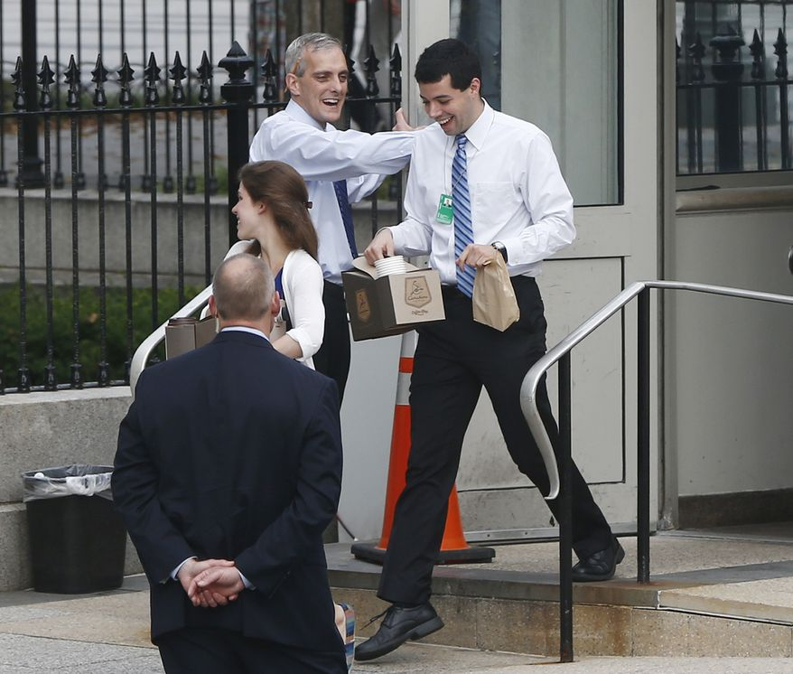 White House Chief of Staff Denis McDonough (center) greets federal employees at the entrance to the Eisenhower Executive Office Building on the White House campus in Washington as they return to work on Thursday, Oct. 17, 2013. Lawmakers on Wednesday voted to avoid a financial default and reopen the government after a 16-day partial shutdown. (AP Photo/Charles Dharapak)