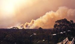 In this photo provided by the New South Wales Rural Fire Service, smoke rises from a fire near Springwood, west of Sydney, Thursday, Oct. 17, 2013. Nearly a hundred wildfires are burning across Australia's New South Wales state, more than a dozen of which are out of control, as unseasonably hot temperatures and strong winds fanned flames across the parched landscape. (AP Photo/New South Wales Rural Fire Service)