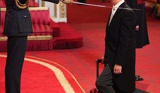 Head teacher Kenneth Gibson of Jarrow, England, receives his knighthood from Britain's Prince William during an investiture ceremony at Buckingham Palace in London on Thursday, Oct. 17, 2013. It is the first time the prince has officiated at a royal investiture. (AP Photo/Jonathan Brady, Press Association)