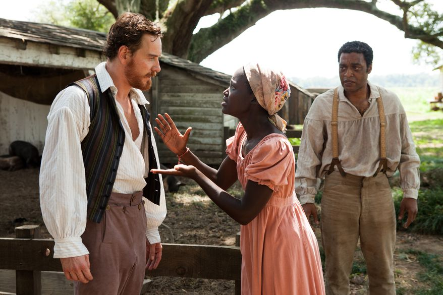 """Michael Fassbender, left, Lupita Nyong'o, and Chiwetel Ejofor, right, in a scene from """"12 Years A Slave."""" (AP Photo/Fox Searchlight, Francois Duhamel)"""