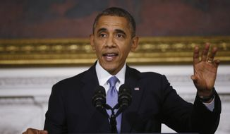 President Barack Obama speaks in the State Dining Room of the White House in Washington, Thursday, Oct. 17, 2013. Lawmakers Wednesday voted to avoid a financial default and reopen the government after a 16-day partial shutdown. (AP Photo/Charles Dharapak)