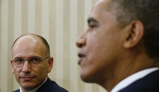 Italy's Prime Minister Enrico Letta, left, looks towards President Barack Obama as he makes a statement to reporters in the Oval Office at the White House in Washington, Thursday, Oct. 17, 2013. The leaders discussed trade and investment, NATO, North Africa, and the Middle East during their bilateral meeting. (AP Photo/Charles Dharapak)