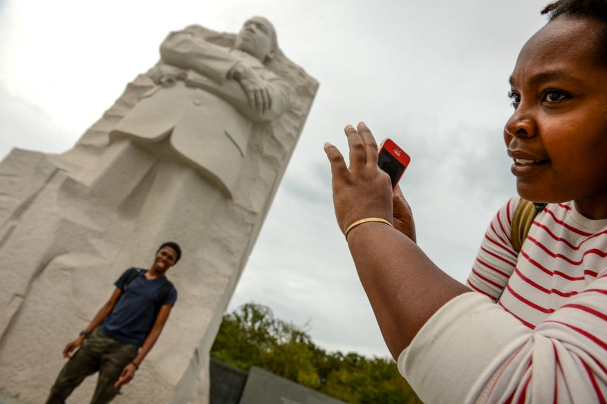 College students Yashua Clemons [cq] and Bevelyn Ukah [cq] of Greensboro, N.C. visit the Martin Luther King Jr. Memorial on the first day monuments on the National Mall reopen after the government shutdown, Washington, D.C., Thursday, October 17, 2013. (Andrew Harnik/The Washington Times)