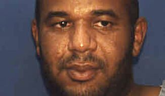 This undated photo provided by the Florida Department. of Corrections shows Joseph Jenkins. Jenkins and Charles Walker were mistakenly released from prison in Franklin County, Fla.,  in late September and early October.  According to authorities, the the two convicted murderers were released with forged documents. A manhunt is under way for the two men. (AP Photo/Florida Department of Corrections)