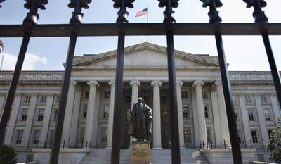 ** FILE ** In this Monday, Aug. 8, 2011, file photo, a statue of former Treasury Secretary Albert Gallatin stands outside the Treasury Building in Washington. (AP Photo/Jacquelyn Martin, File)