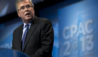 """FILE - In this March 15, 2013 file photo, former Florida Gov. Jeb Bush speaks during the Ronald Reagan Dinner at the 40th annual Conservative Political Action Conference in National Harbor, Md. Weighing in while hosting an education conference in Boston, the potential 2016 presidential candidate argued that congressional Republicans represent """"the mirror opposite"""" of the successes of GOP governors outside the capital. (AP Photo/Jacquelyn Martin, File)"""