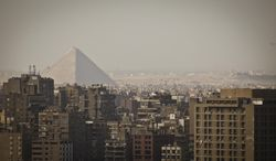 The Giza Pyramids dominate the skyline in Giza, Egypt, Cairo's sister city, Friday, Oct. 18, 2013. Supporters of ousted President Mohammed Morsi held demonstrations around the country to protest against the military-backed interim government and its crackdown on the Muslim Brotherhood. Security, already volatile since 2011, has worsened since the military overthrew Morsi following mass protests calling for his resignation. (AP Photo/Maya Alleruzzo)