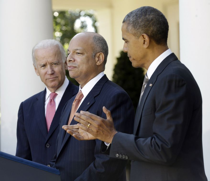 President Barack Obama, right, stands with Jeh Johnson, center, his choice for the next Homeland Security Secretary, and Vice President Joe Biden, left, in the Rose Garden at the White House in Washington, Friday, Oct. 18, 2013. Johnson was general counsel at the Defense Department during the wars in Iraq and Afghanistan.(AP Photo/Pablo Martinez Monsivais)